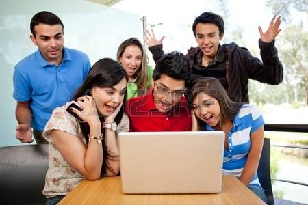 10453596-group-of-surprised-students-at-the-university-with-a-computer